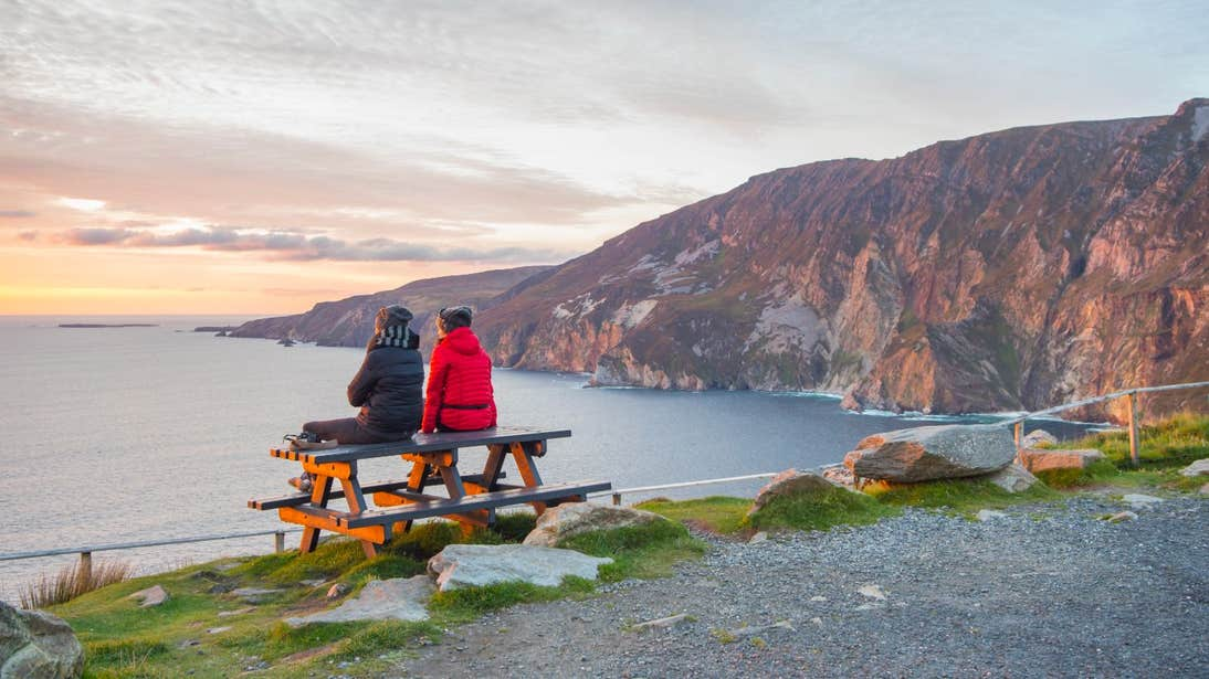 Two friends sitting on a table at Slieve League in Co. Donegal.