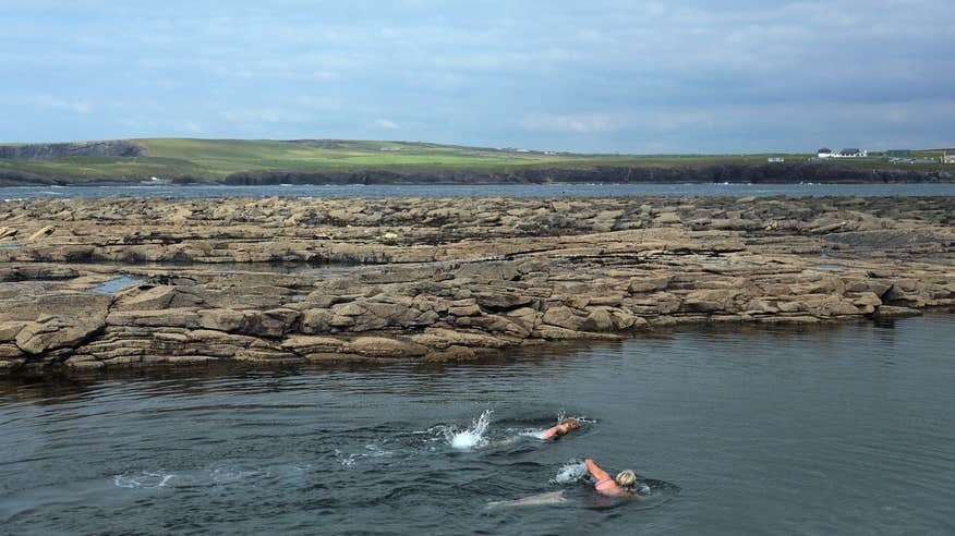 Take a plunge in The Pollock Holes in Kilkee.