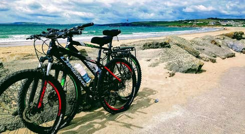 Two bikes parked up with Garrettstown Beach and the sea in the background