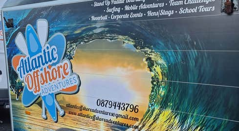 Trailer attached to a van showing logo and contact number for Atlantic Offshore Adventures