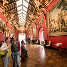 Friends looking at art inside Kilkenny Castle, Kilkenny City, County Kilkenny