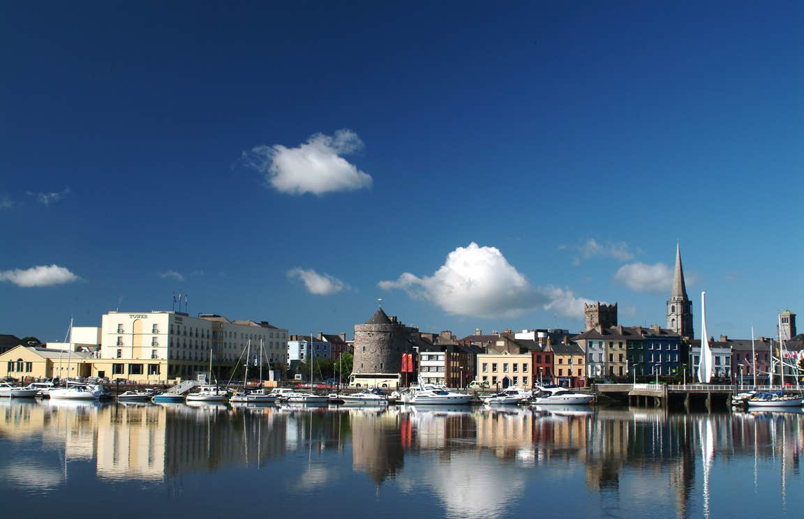 View Of Waterford Quay in Waterford City on a sunny day with buildings in the background.