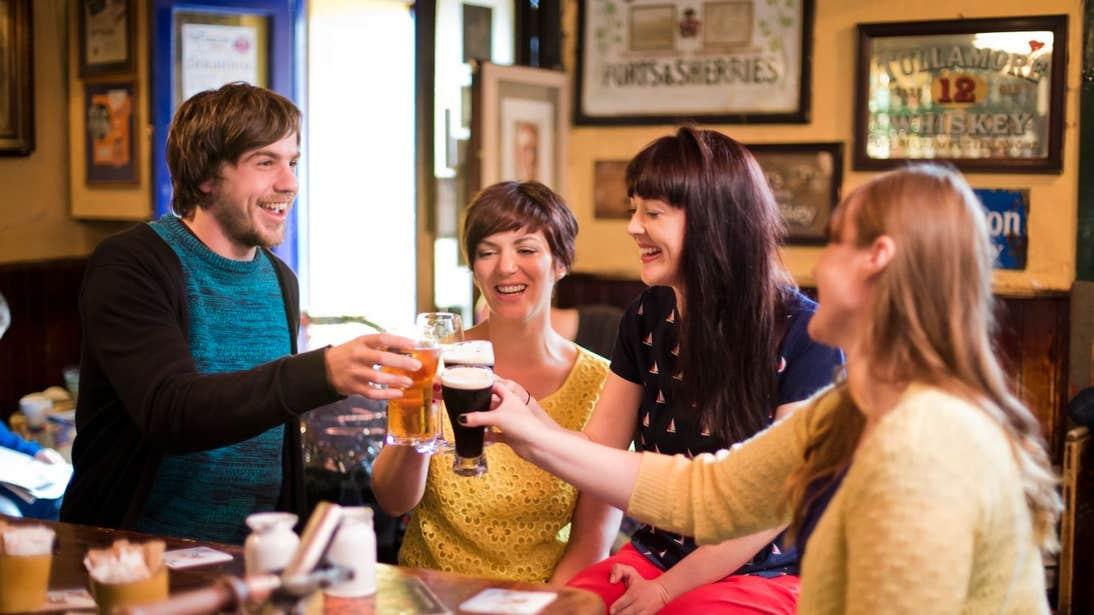 Friends enjoying a drink in a pub in Kenmare, Kerry.