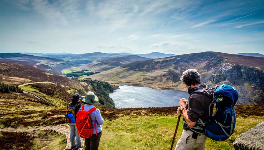 Hikers enjoying a view of Lough Tay from above