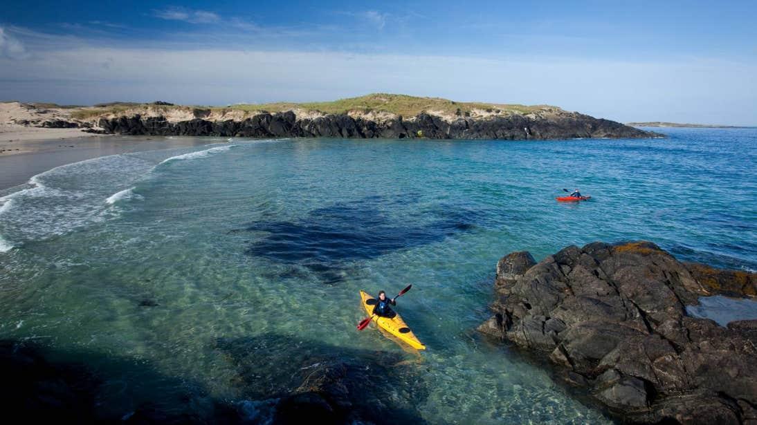 Two people kayaking in Mannin Bay in Connemara, Galway.