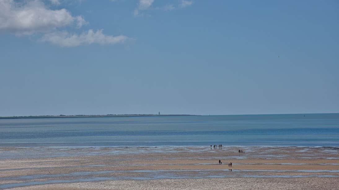 People walking on the strand at Duncannon Beach, Wexford