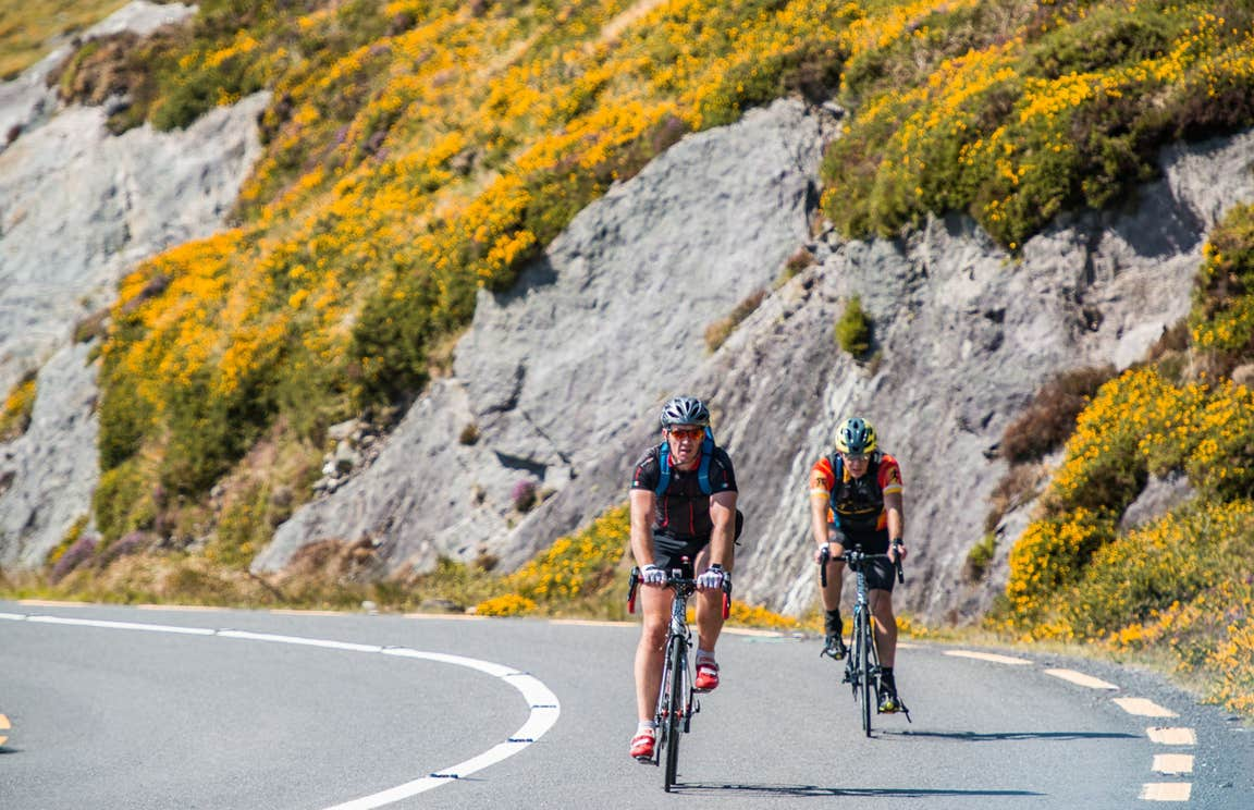 Two cyclists cycling the Ring of Kerry, County Kerry