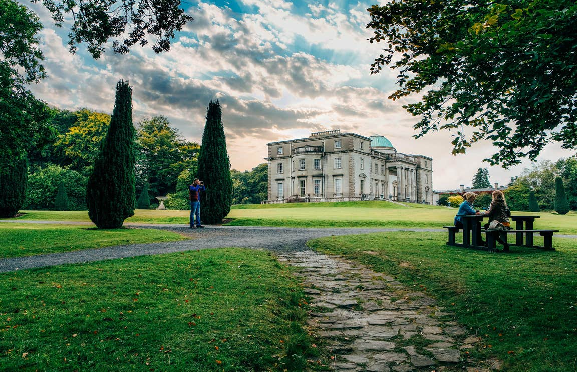Large gardens and people sitting at a table at Emo Court County Laois