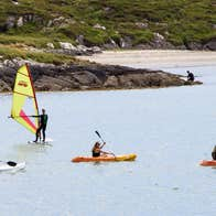 Three kayakers and 1 windsurfer in Derrynane