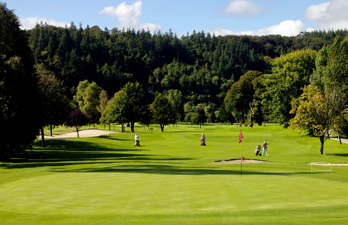 People playing golf on a sunny day at Woodenbridge Golf Course, Wicklow
