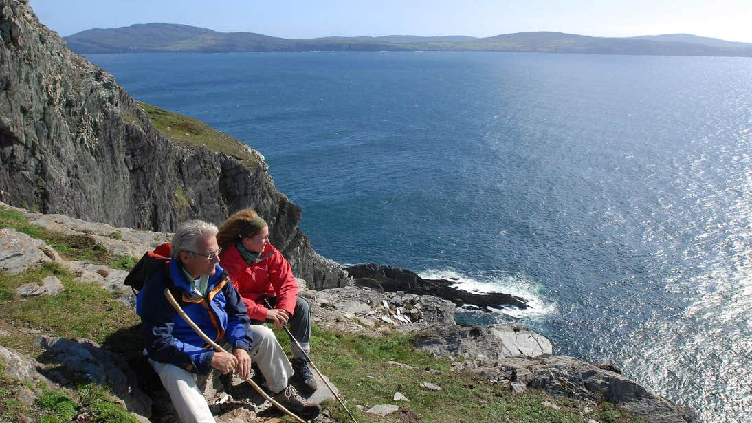 People taking a rest beside the sea on Sheep's Head, County Cork
