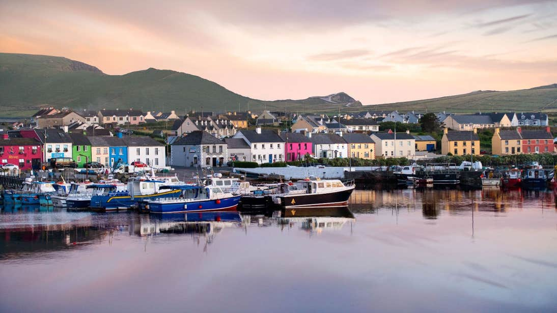 Boats in front of colourful buildings in Portmagee, Co. Kerry