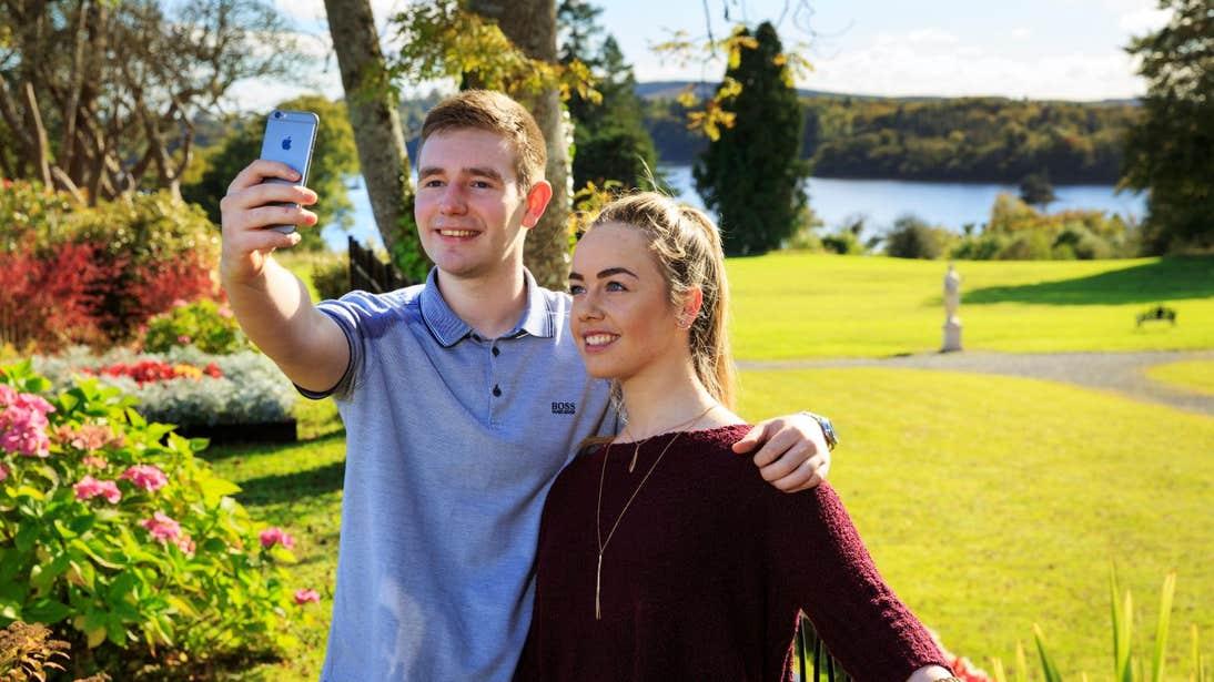 Couple taking a selfie at Kilronan Castle Estate in Roscommon