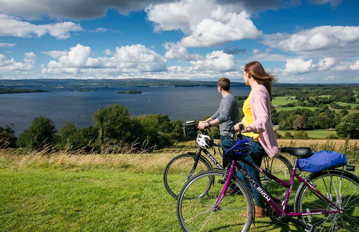 Cyclists overlooking Lough Derg on a sunny day.