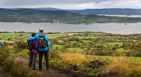 A couple hiking and looking out over water in Tipperary