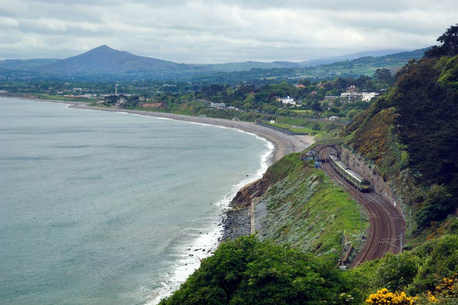 The DART line running past mountains by the coast at Vico, Dalkey, Dublin
