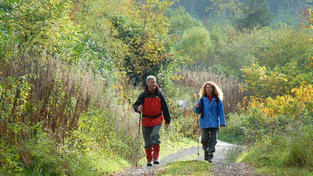 A man and a woman dressed in hiking gear walking the Attychraan Loop Walk