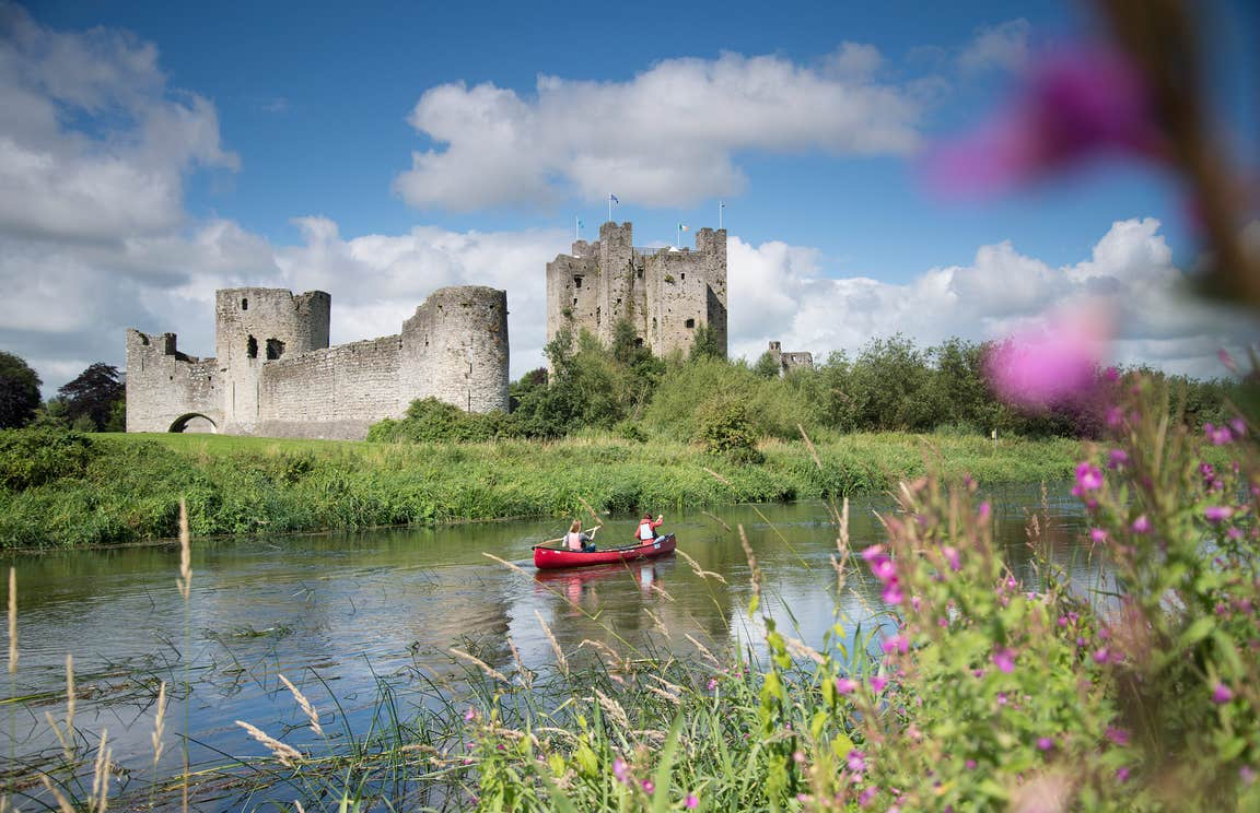 A boat paddling in a river outside Trim Castle in Meath
