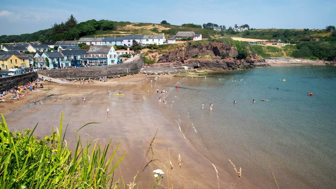 Clear water and golden sand at Dunmore East, Waterford