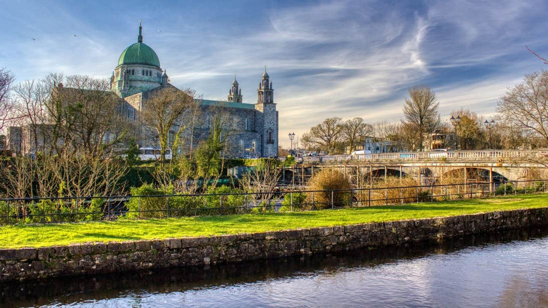 Gloomy skies over Galway Cathedral and a view of the Salmon Weir Bridge over the River Corrib