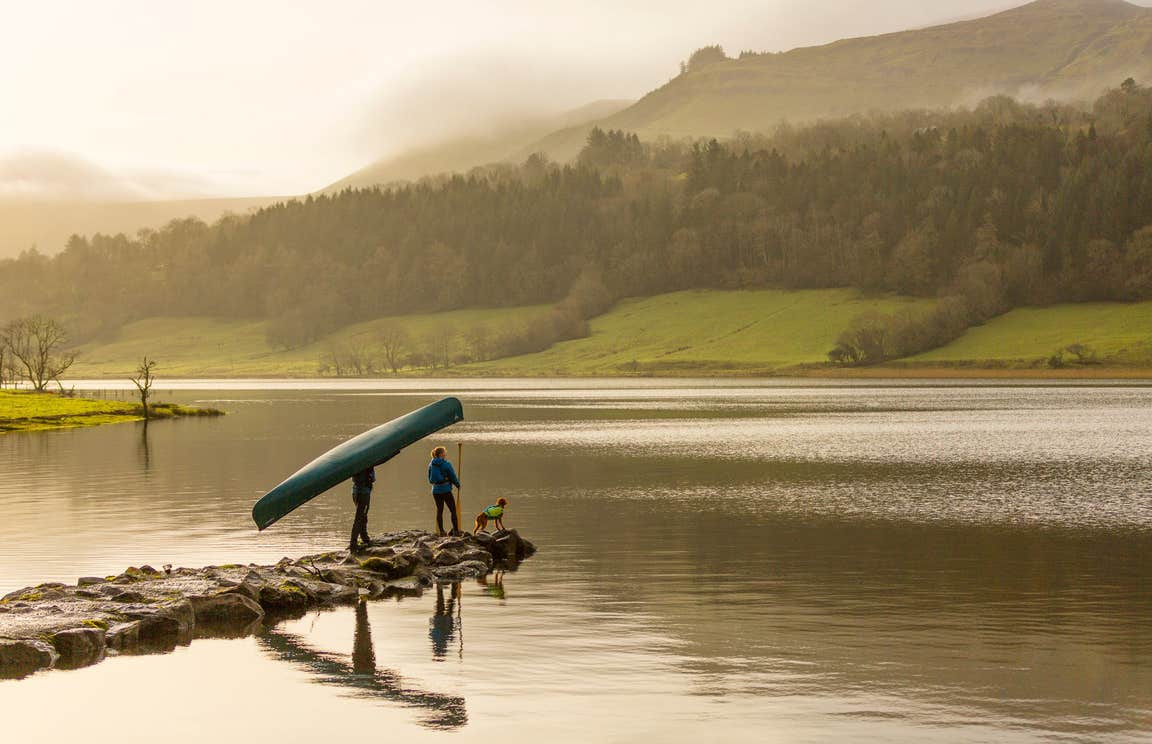 Image of a couple with their dog on Glencar Lake in County Leitrim