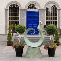A sculpture outside a bright blue door at King House Georgian Mansion in County Roscommon.