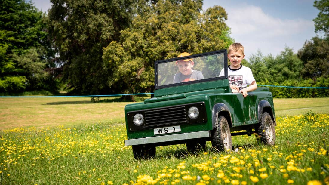 Children driving a toy car in Lough Key Forest and Activity Park, Roscommon