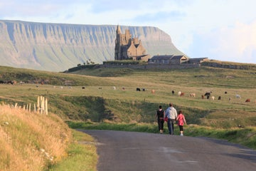 Image of people walking along the road in Mullaghmore in County Sligo