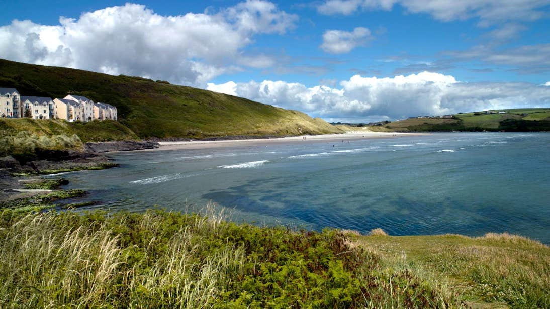 A view of the golden beach and blue waters of Inchydoney Beach