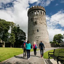 People walking up to Nenagh Castle in County Waterford