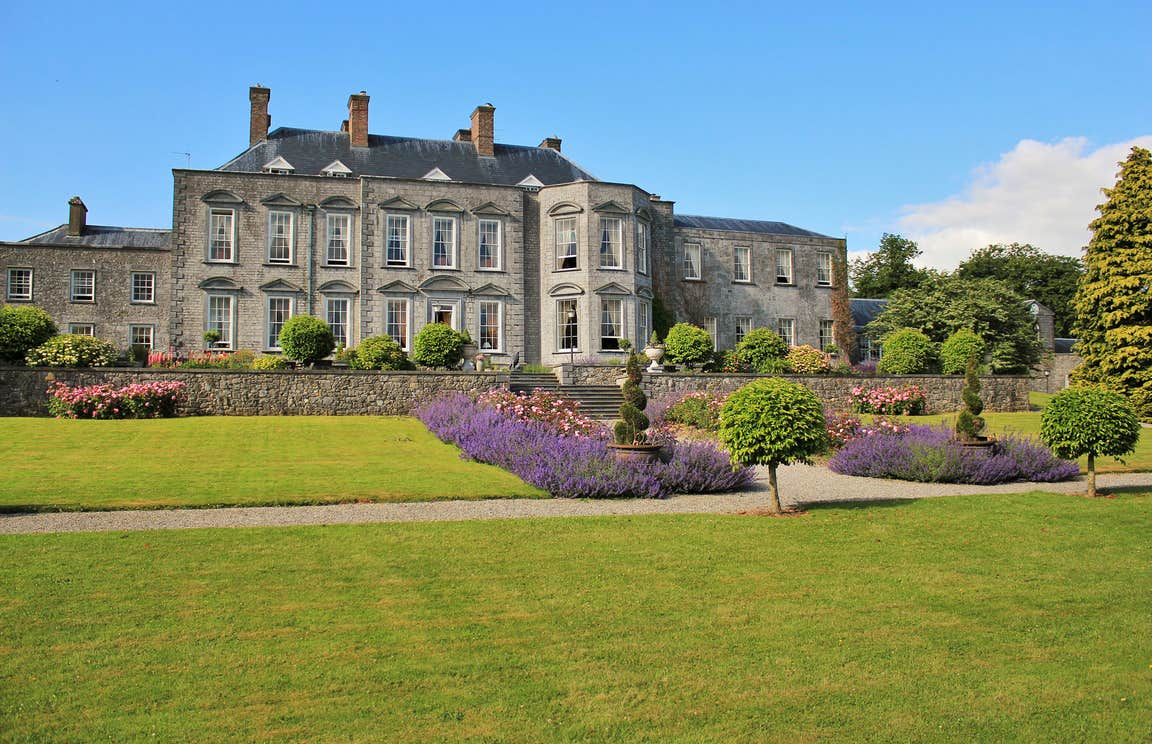 Immaculate lawns and flowerbeds outside Castle Durrow back garden in County Laois