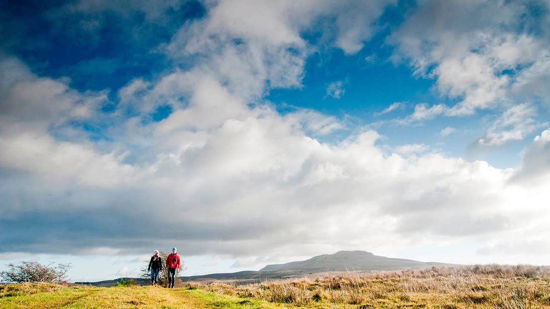Blue skies over a couple walking in Cavan Burren Park, County Cavan