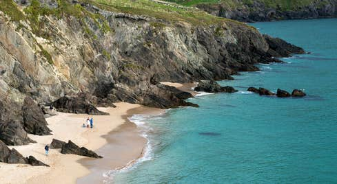 People on the golden sands of the Blasket Islands