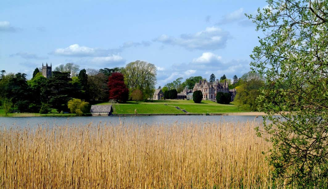 Green grass and blue water in front of Castle Leslie Estate, Monaghan