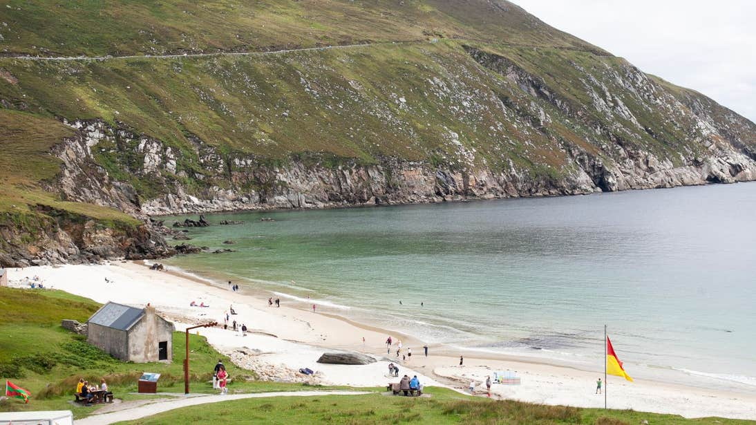 People swimming at Keem Bay, Achill Island, Mayo