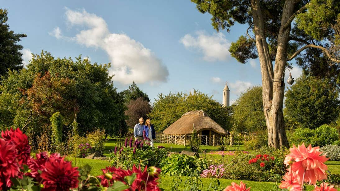 A couple walking through the National Botanic Gardens with views of vibrant flowers and plants