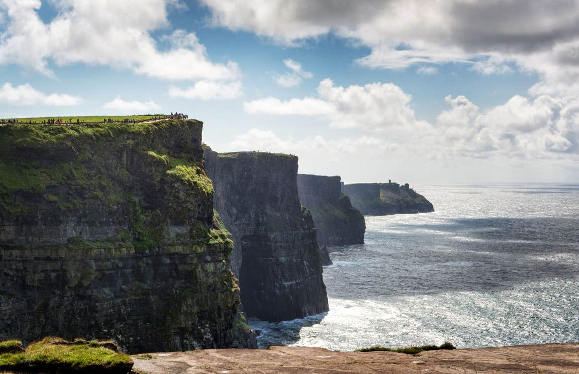 Sunny day with some low lying clouds at Cliffs of Moher, County Clare