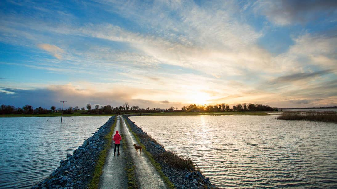 A woman and her dog at Saint's Island, Longford