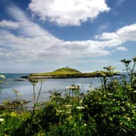 A view out to Ballycotton Island, County Cork on a sunny day