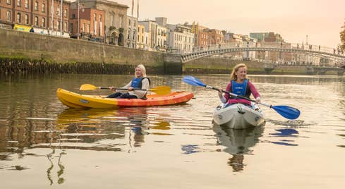 Two people kayaking on the River Liffey in Dublin