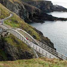 People walking across the bridge at Mizen Head in County Cork.