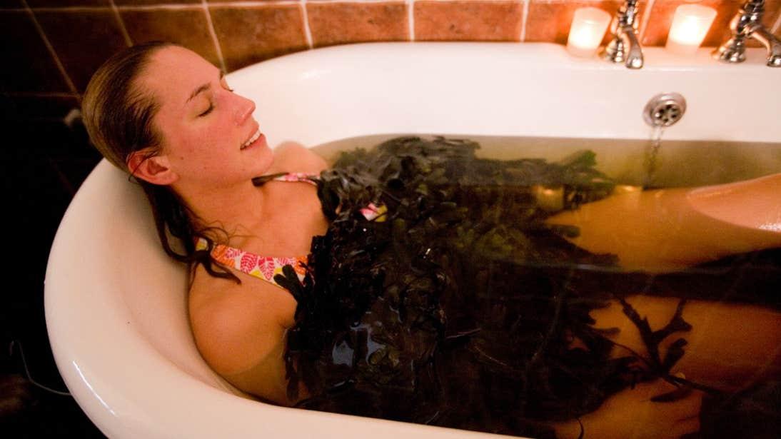 Woman relaxing in a Voya Seaweed Bath, Strandhill, Sligo