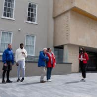 A group with a tour guide outside Waterford Treasures Museums