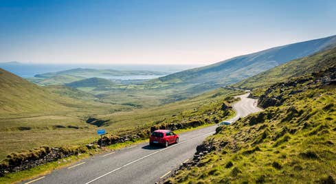 Car driving on the road on the Connor Pass, County Kerry