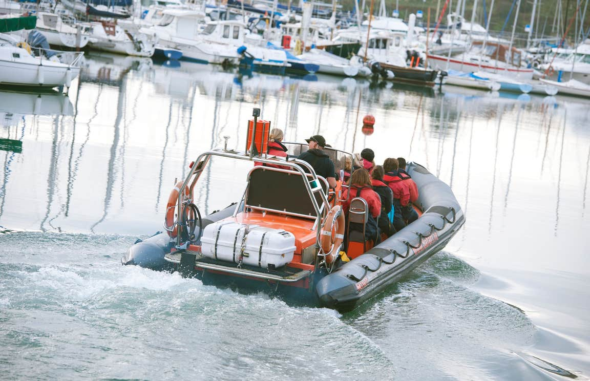 A group of people on a boat at Kinsale Harbour in County Cork