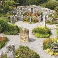 Gravel pathways meander through standing stones and shrubbery