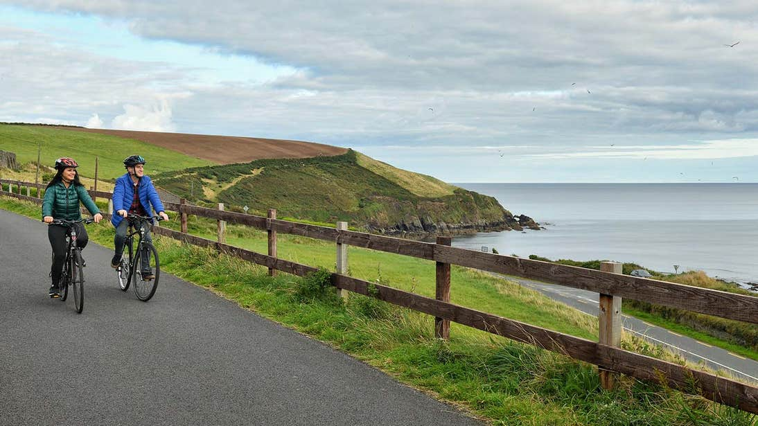 Couple cycling the Waterford Greenway to Dungarvan, Co. Waterford