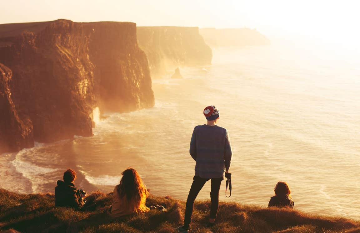 Four people admiring the views from the Cliffs of Moher