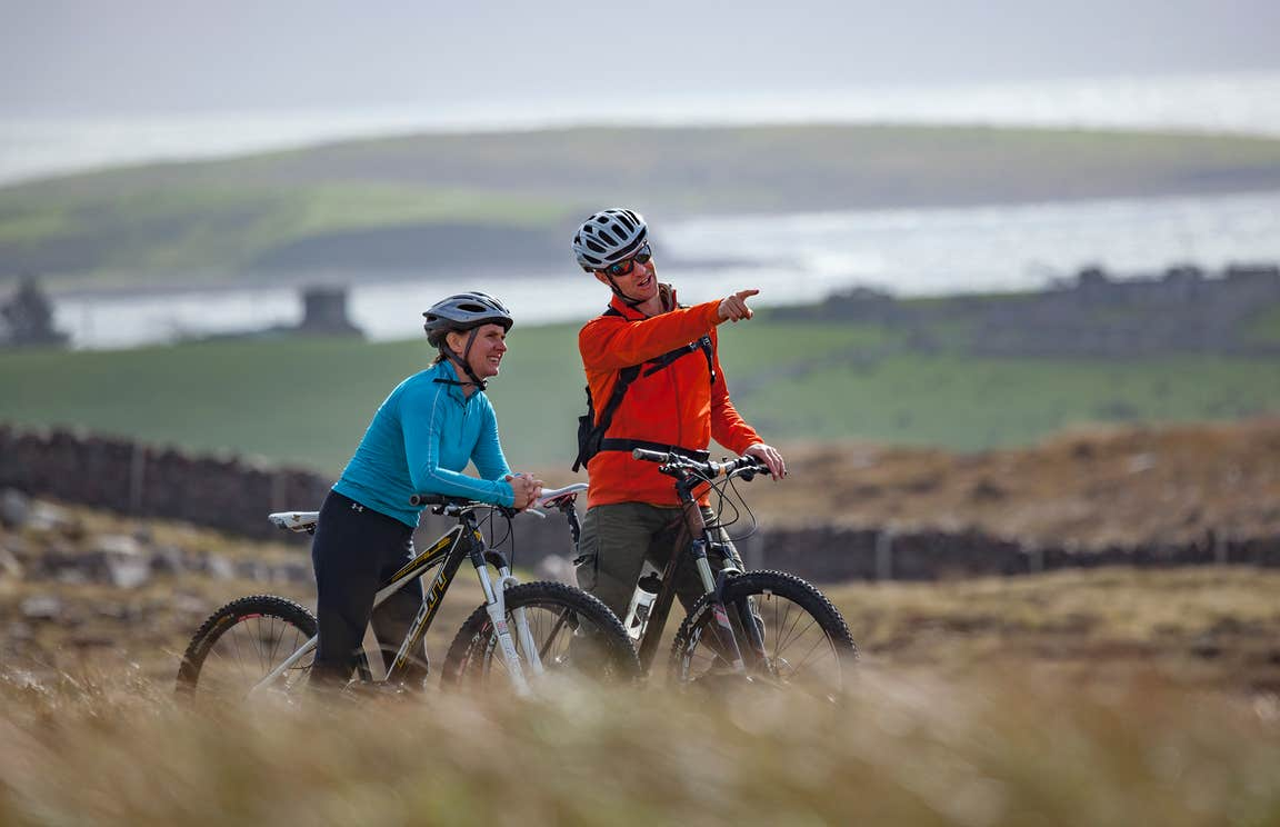 A couple cycling along the Great Western Greenway, Mayo