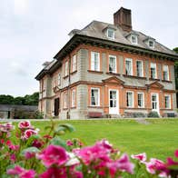 Green grass and colourful flowers at Beaulieu House and Gardens, County Louth